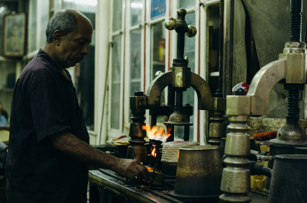 A man making hats in the old city