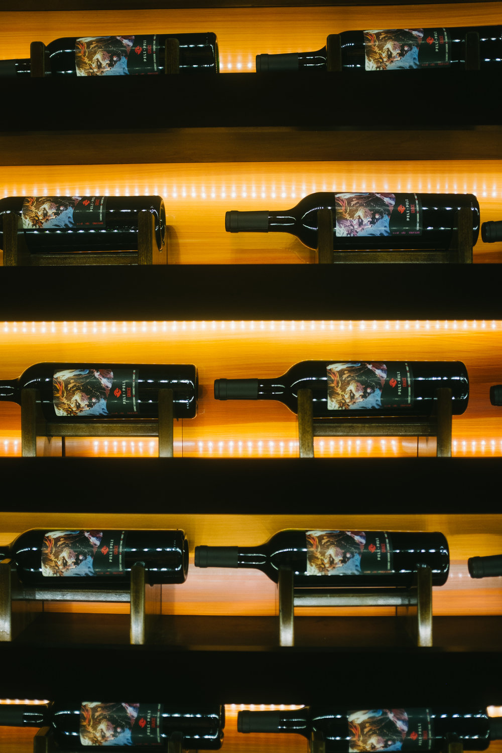 "South Africa is home to the worlds longest ""wine drive;"" Peli Peli appropriately carries a large selection of house wines creatively displayed."