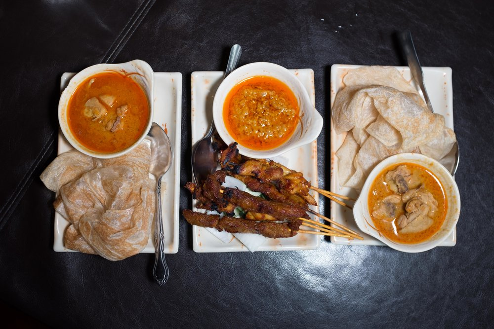 Try the starters (Roti on the outside, and Satay).  The curry flavors from India and the peanut sauces from Asia speak to Malaysia as a hub of pan-Asian fusion food.