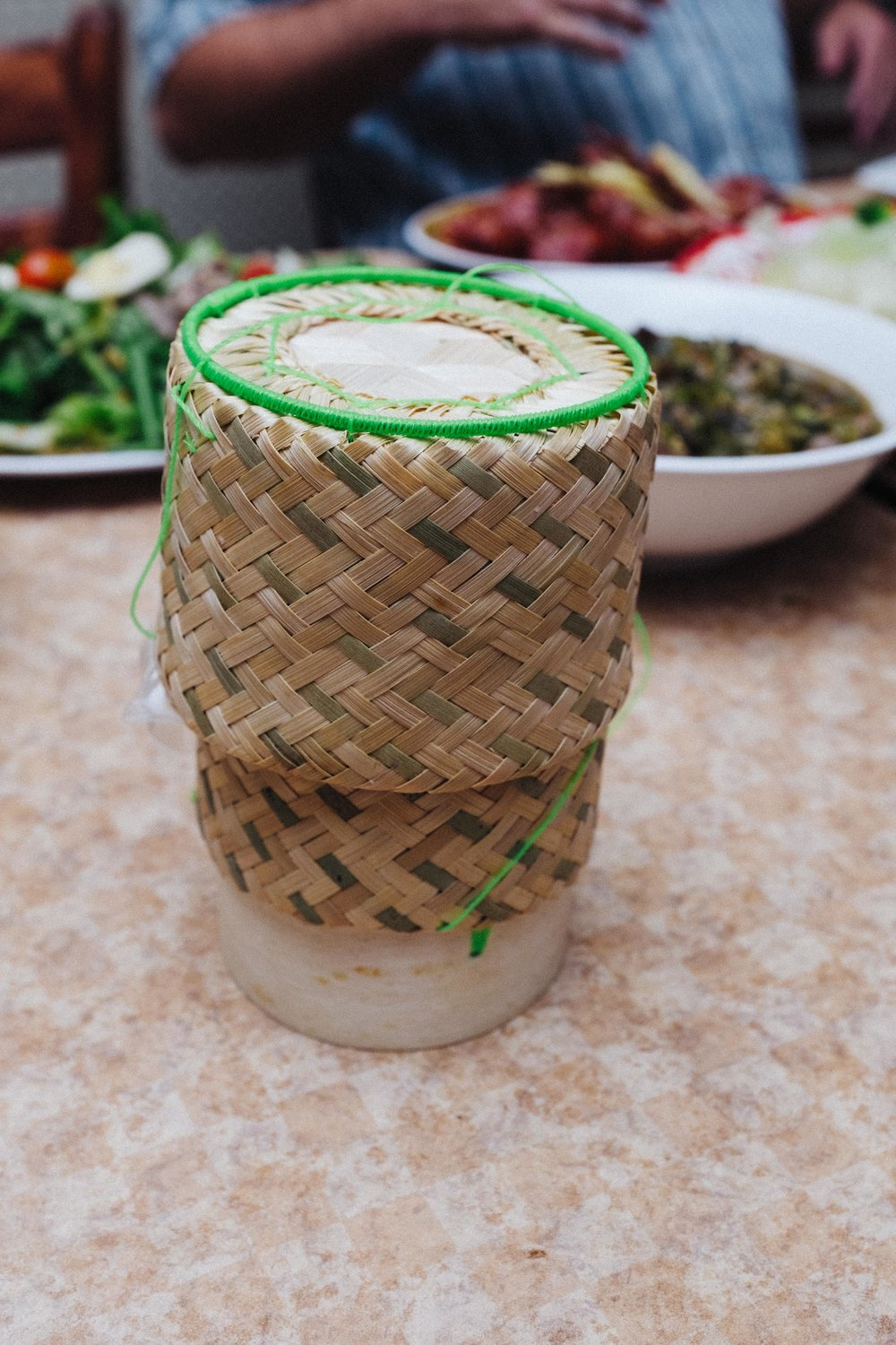 Sticky rice is a three meal a day staple in Laos, traditionally served in these small, hand-made baskets.  It is not only a staple food but serves as an edible utensil.