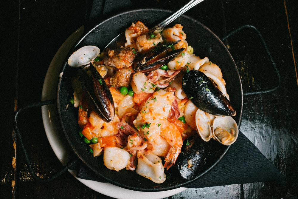 With its location at the mouth of the Atlantic Ocean and the Mediterranean Sea and its storied past as intrepid sailors and explorers, seafood is a perfect choice when sampling Andalucian cuisine.  Pictured above is Paella, the national dish of Spain.