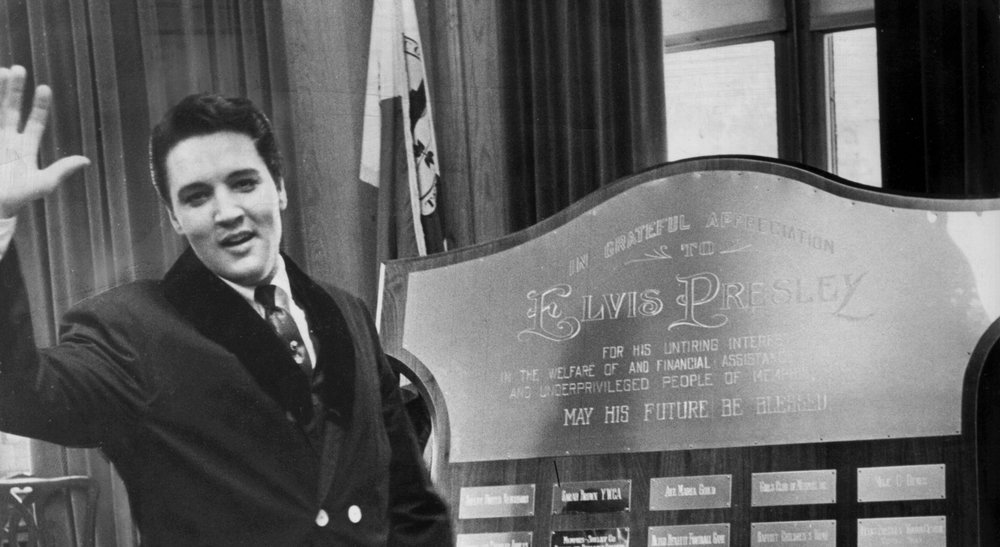 Elvis receiving an award for his assistance with the many charities in Memphis and throughout the country.