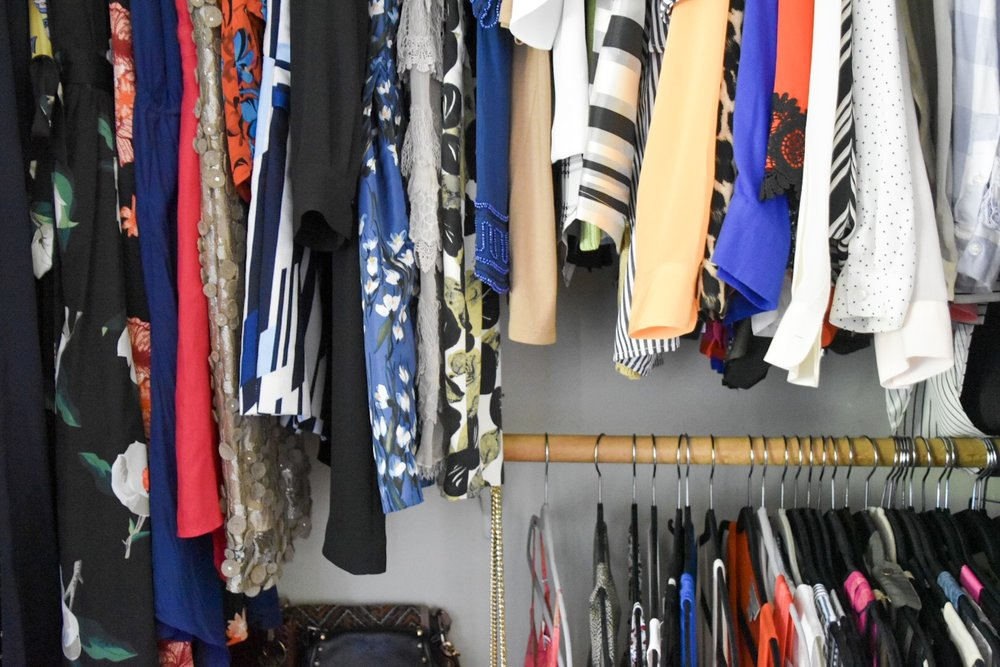 double rack organized closet with velvet hangers by the rath project