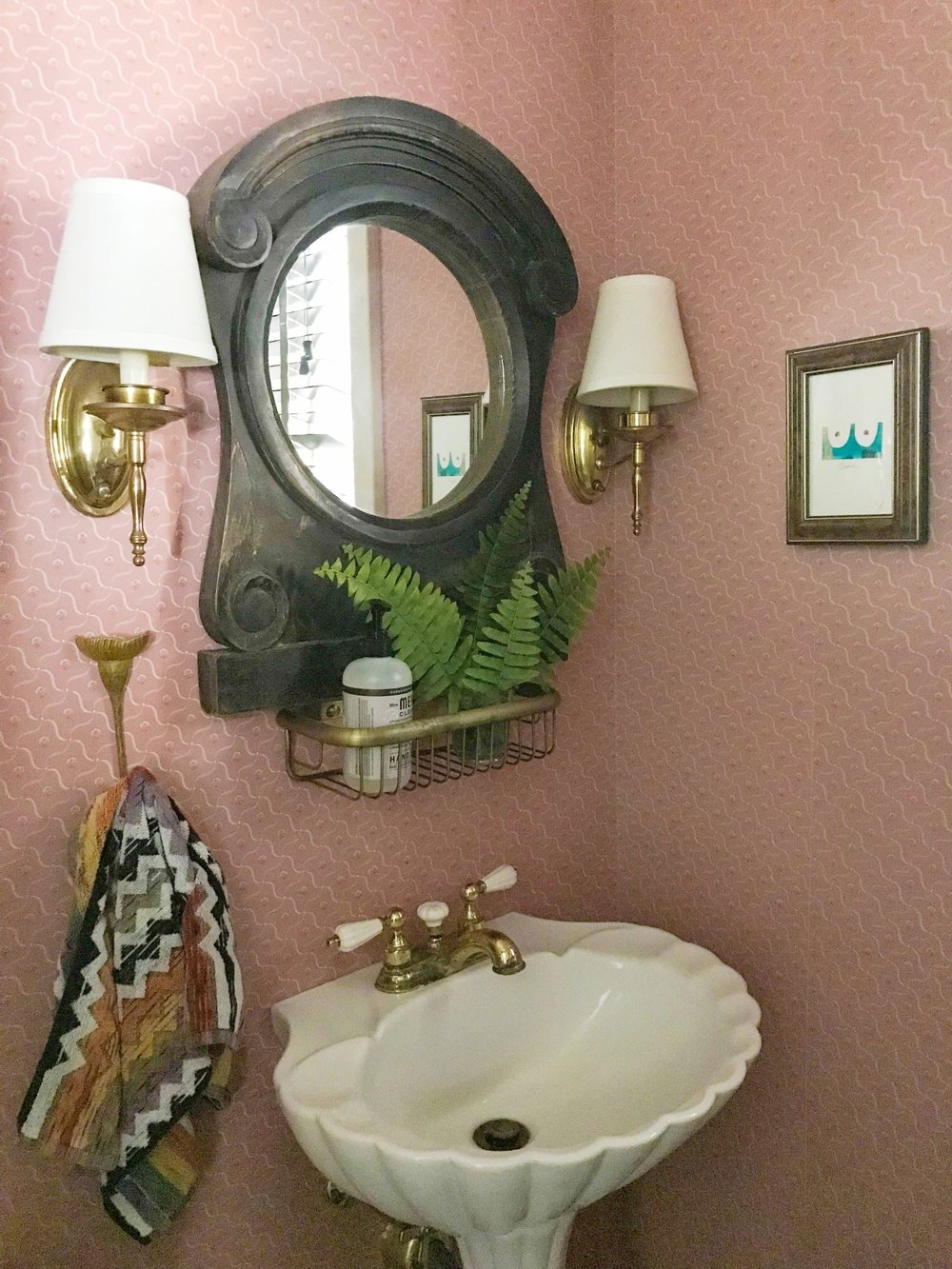 pink powder room pedestal sink and sconces