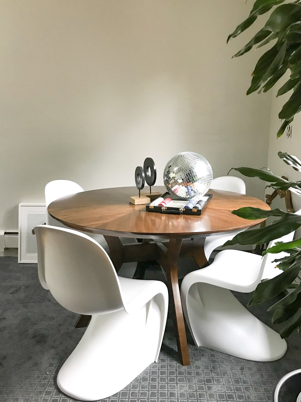 Raymour & Flanigan Pryce dining table paired with modern S chairs