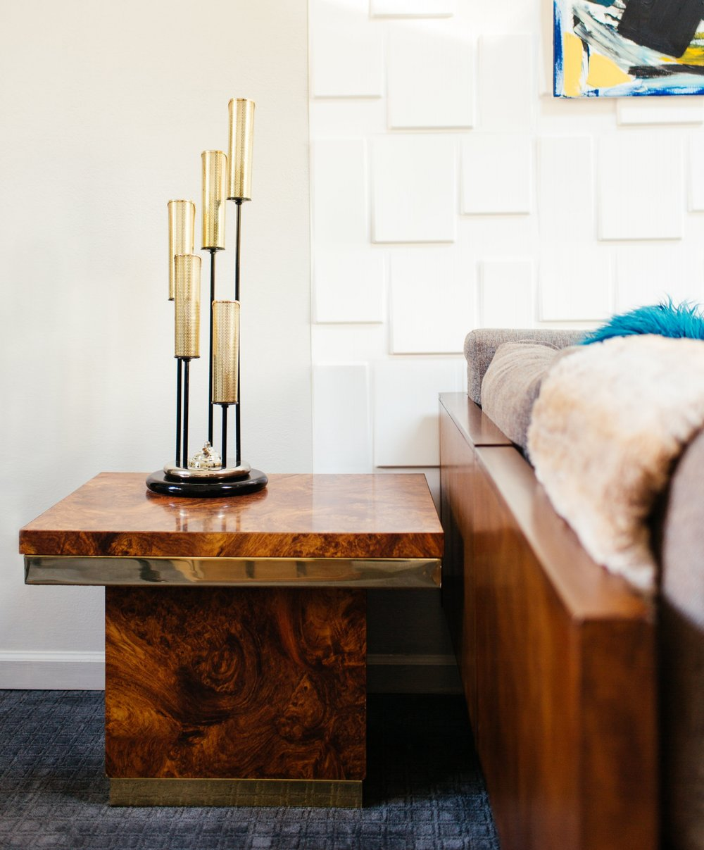 burl side table details in modern eclectic family room design by the rath project