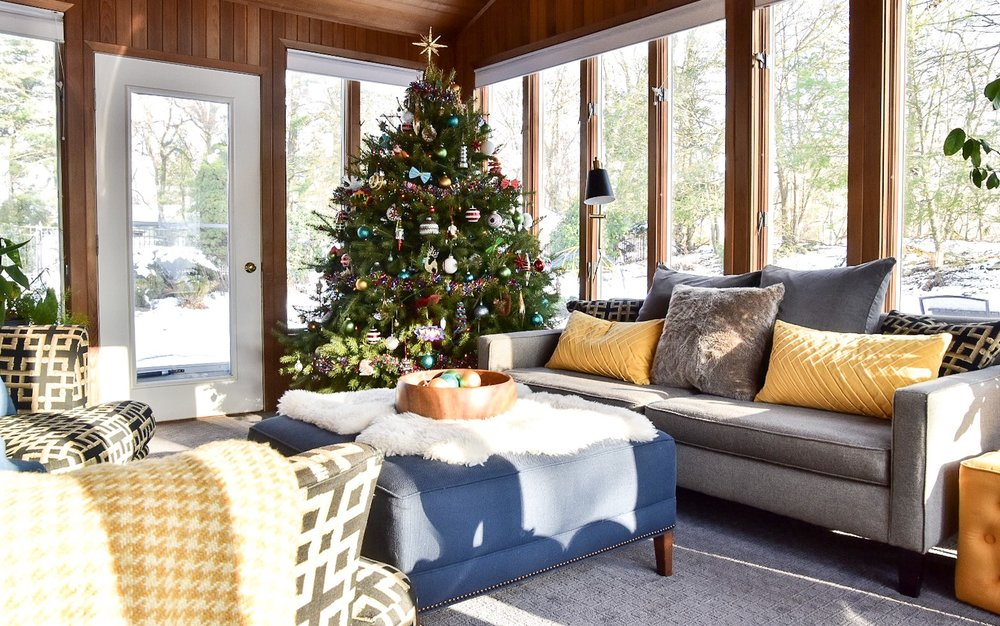 Eclectic color filled sunroom with Christmas tree by the rath project
