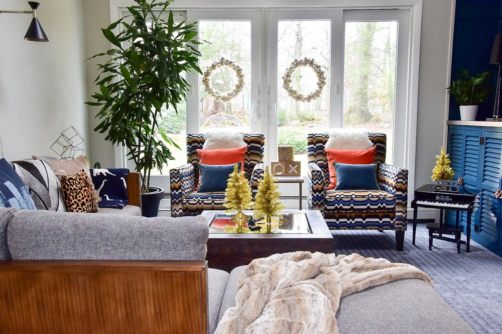 Modern colorful family room decorated for the holidays by the rath project