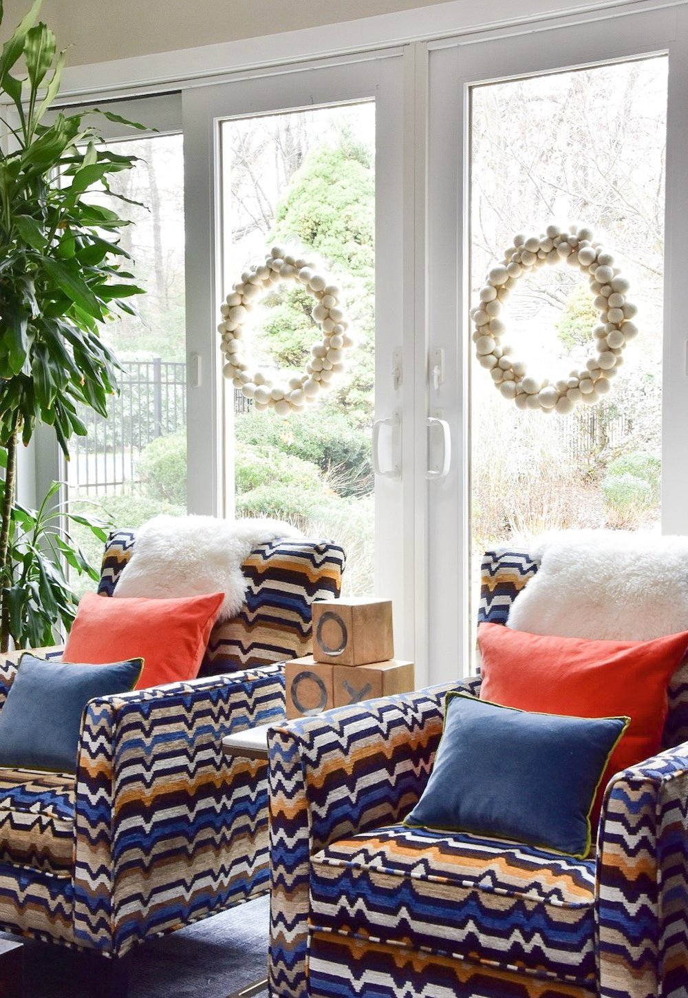 modern colorful pattern filled family room decorated for the holidays by the rath project