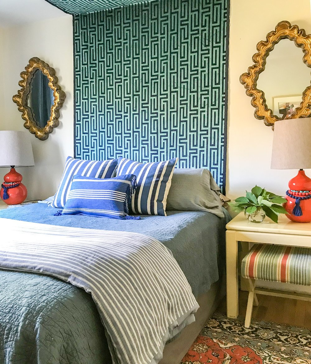 eclectic glamorous colorful guest room with fabric canopy like headboard by the rath project