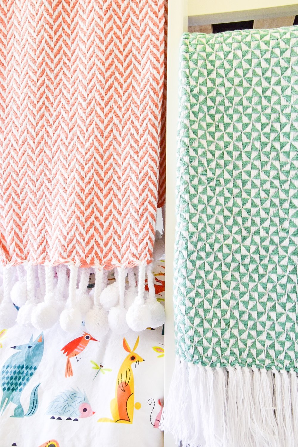 colorful throws for kids room makeover by the rath project