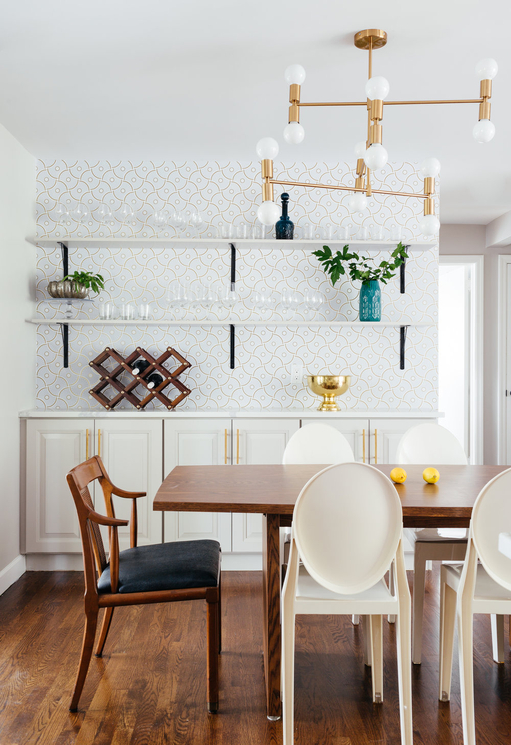 modern traditional dining room renovation with open shelving and custom cabinetry and Temapaper wallpaper room designed by the Rath Project