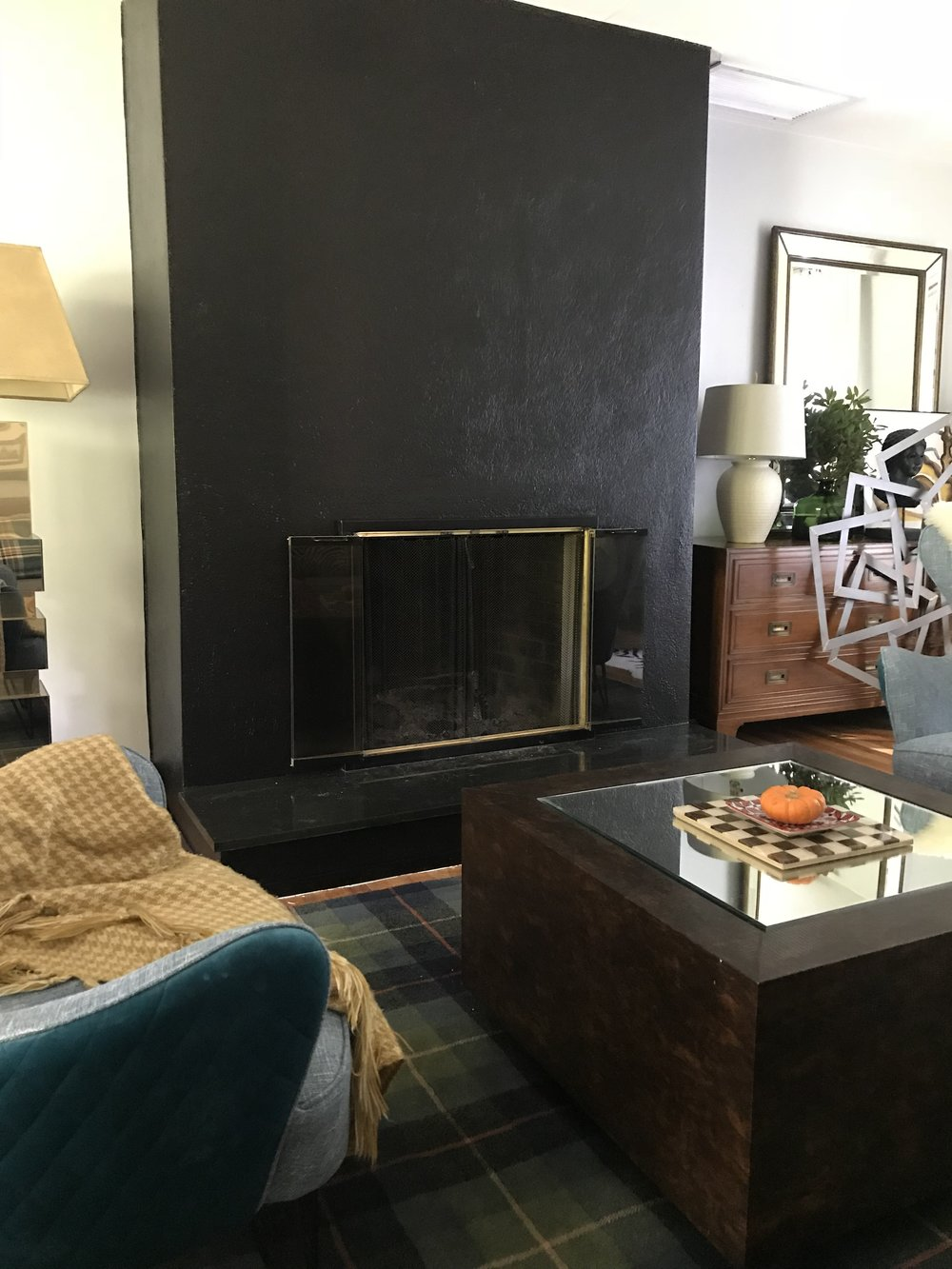 One Room challenge painting the fireplace black by the rath project