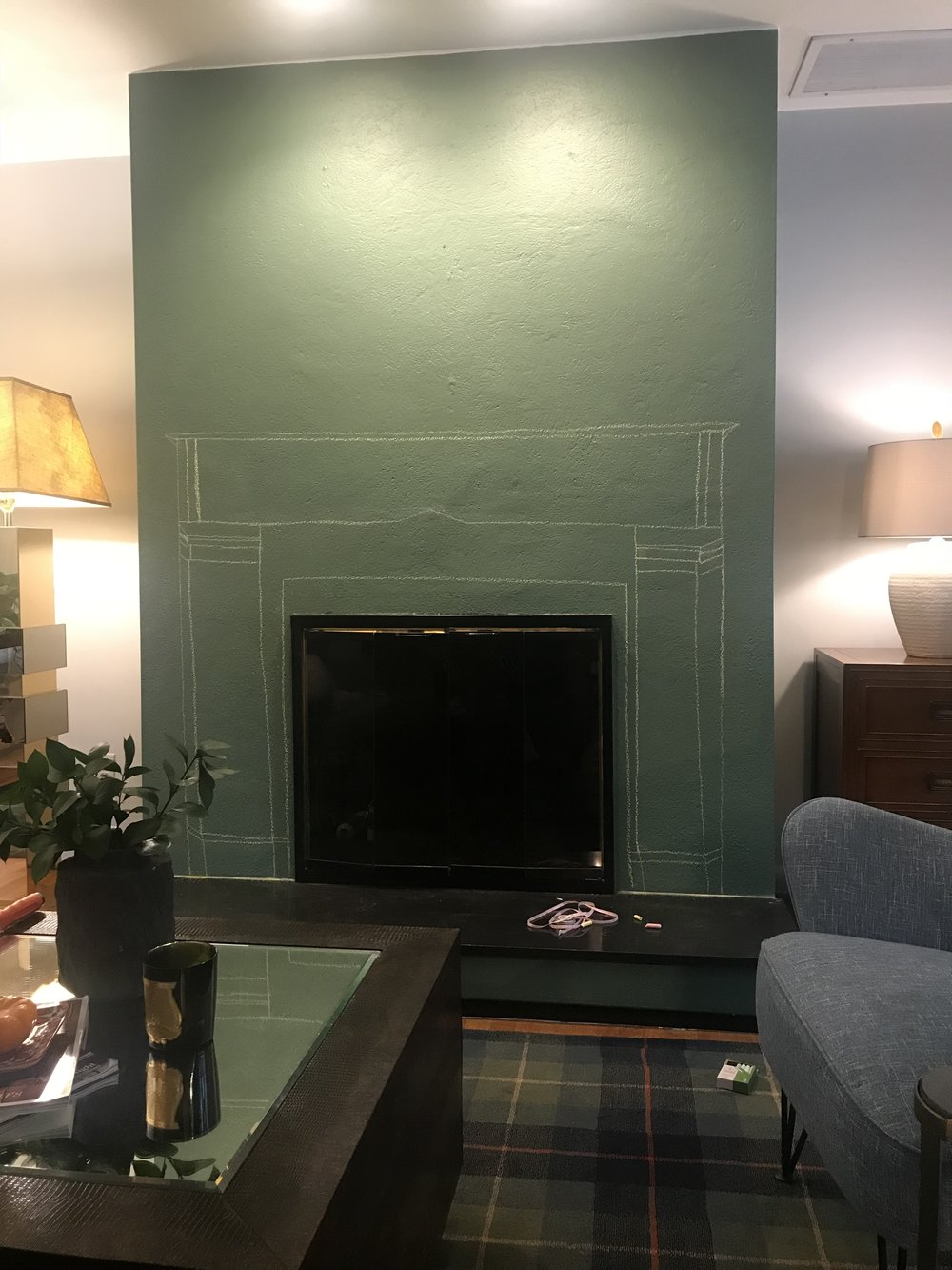 green fireplace with chalk outline mantel drawing