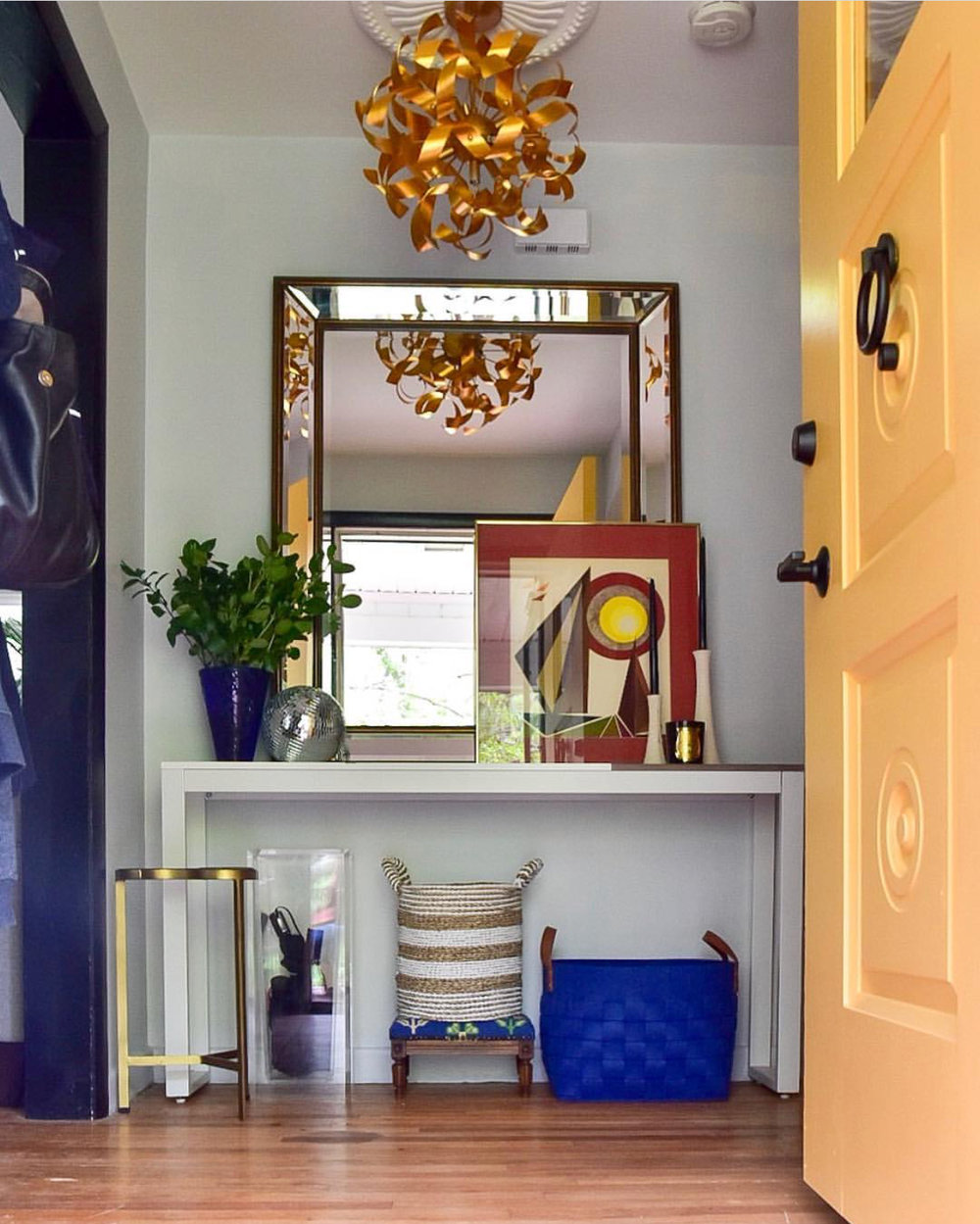 eclectic entry way by the rath project