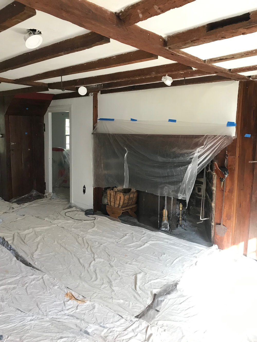 painting and skim coating in progress  one room challenge living room by the rath project