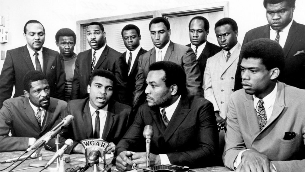 Former Cleveland Browns Hall of Fame running back Jim Brown presides over a meeting of top African-American athletes on June 4, 1967, to show support for boxer Muhammad Ali's refusal to fight in Vietnam. Those present are: (front row) Bill Russell, Muhammad Ali, Jim Brown, Lew Alcindor; (back row) Carl Stokes, Walter Beach, Bobby Mitchell, Sid Williams, Curtis McClinton, Willie Davis, Jim Shorter, and John Wooten. Tony Tomsic/Getty Images