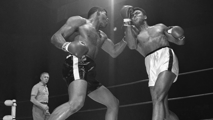 Floyd Paterson, left, delivers a left hook to the chin of Muhammad Ali during a heavyweight title fight in November 1965. –The Associated Press