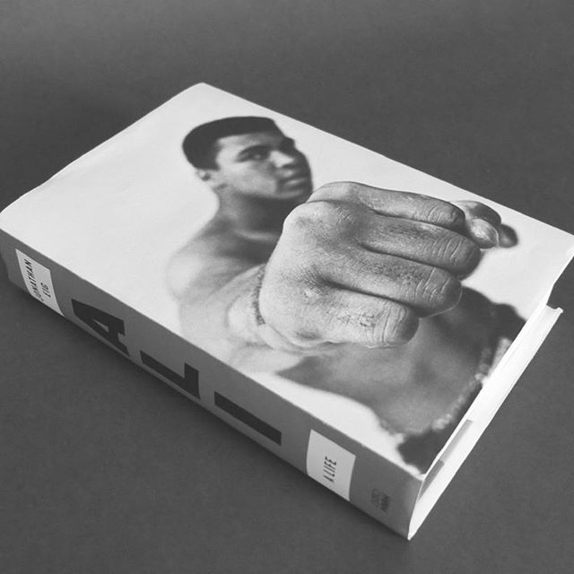 "Happy almost-New Years! We hope that you start off the year soaking in a copy of the New York Times bestseller ""Ali: A Life"" by @joneig."