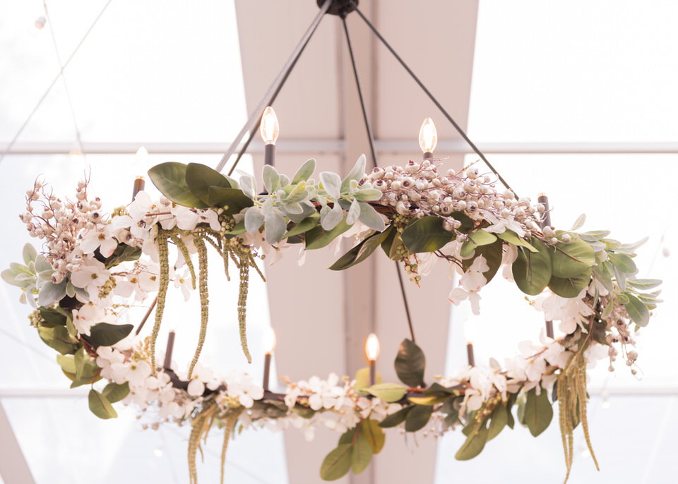 chandelier with floral arrangement