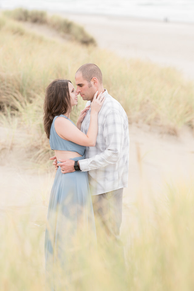 Couple on the beach in the grass formal engagement