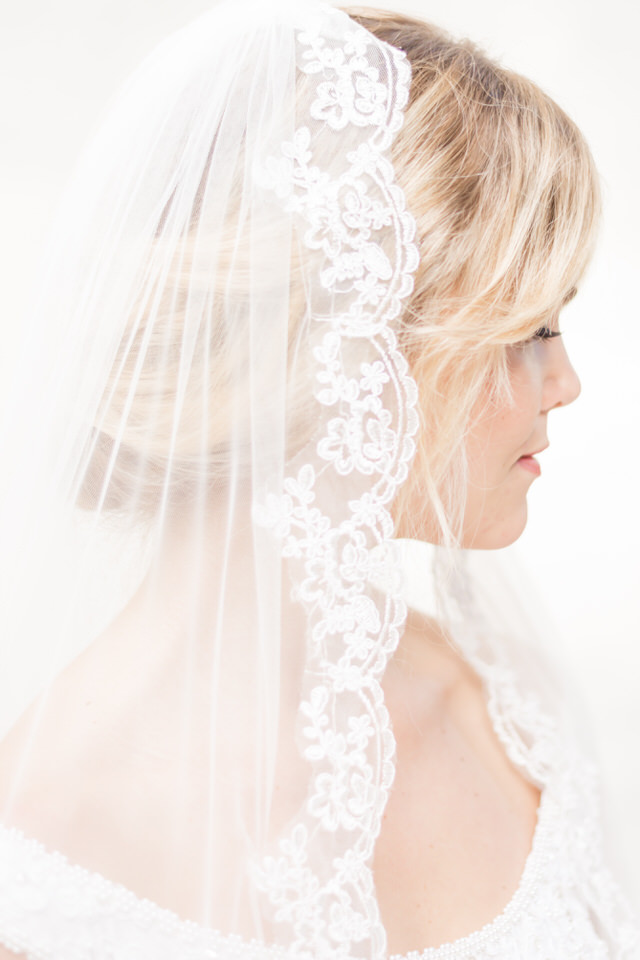 Weddings in Woodinville bride vintage lace veil coral lip bangs-1.jpg
