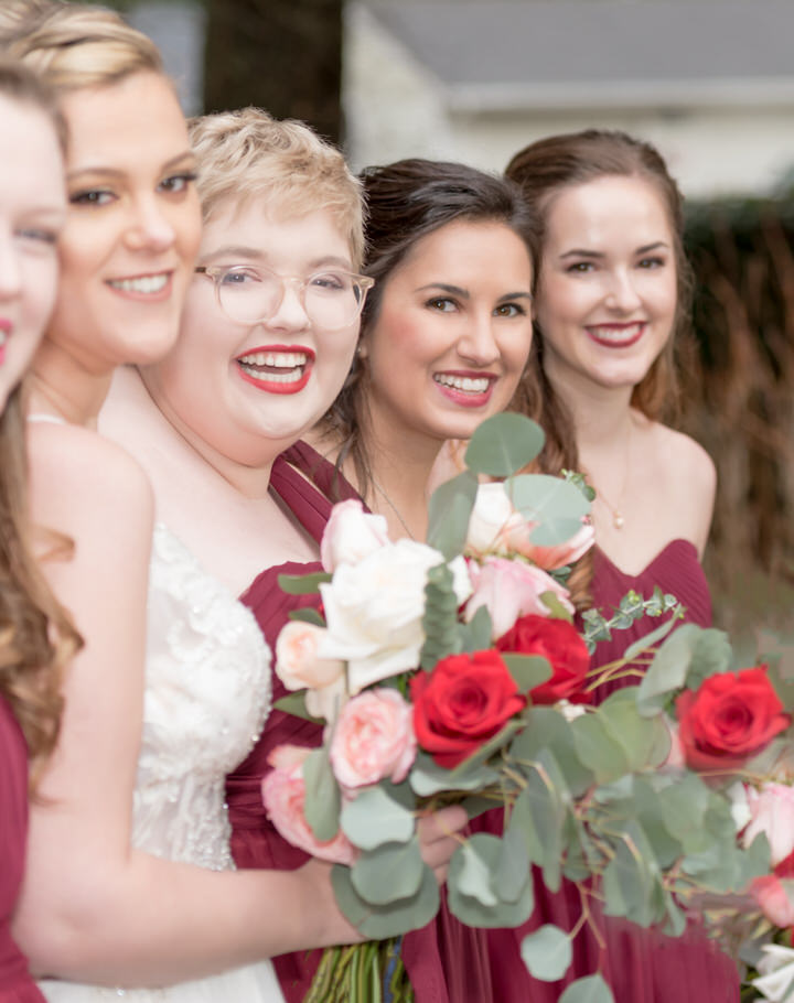 bride and bridesmaids Kitsap wedding cservinphotographs red and pink winter wedding.jpg