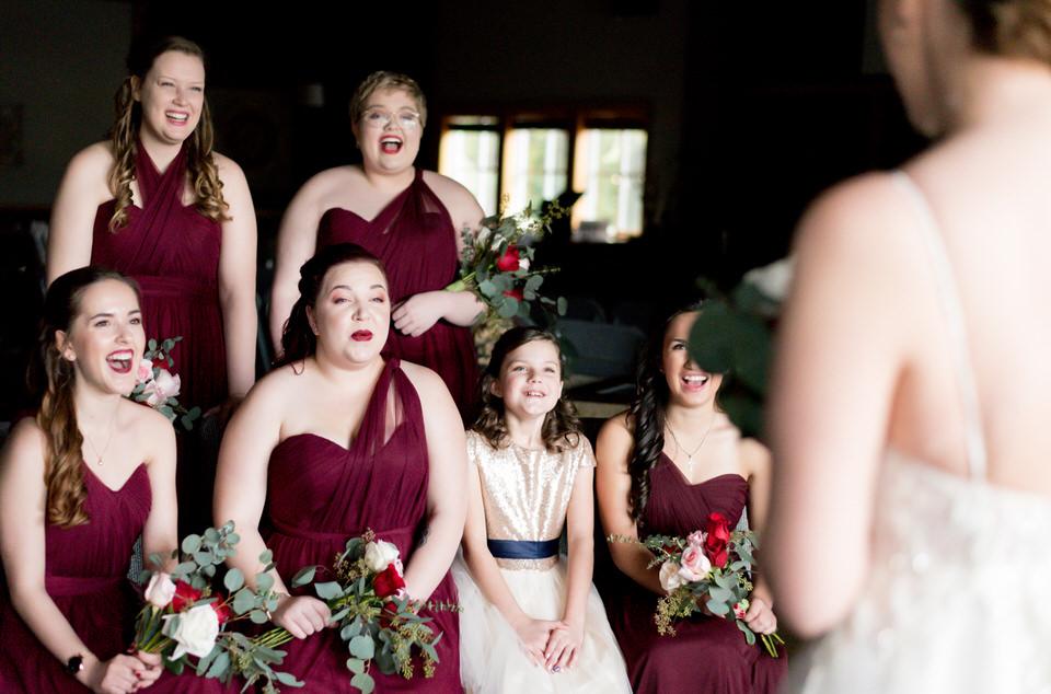 Bridesmaids first look of bride wine dresses winter wedding church Seattle.jpg