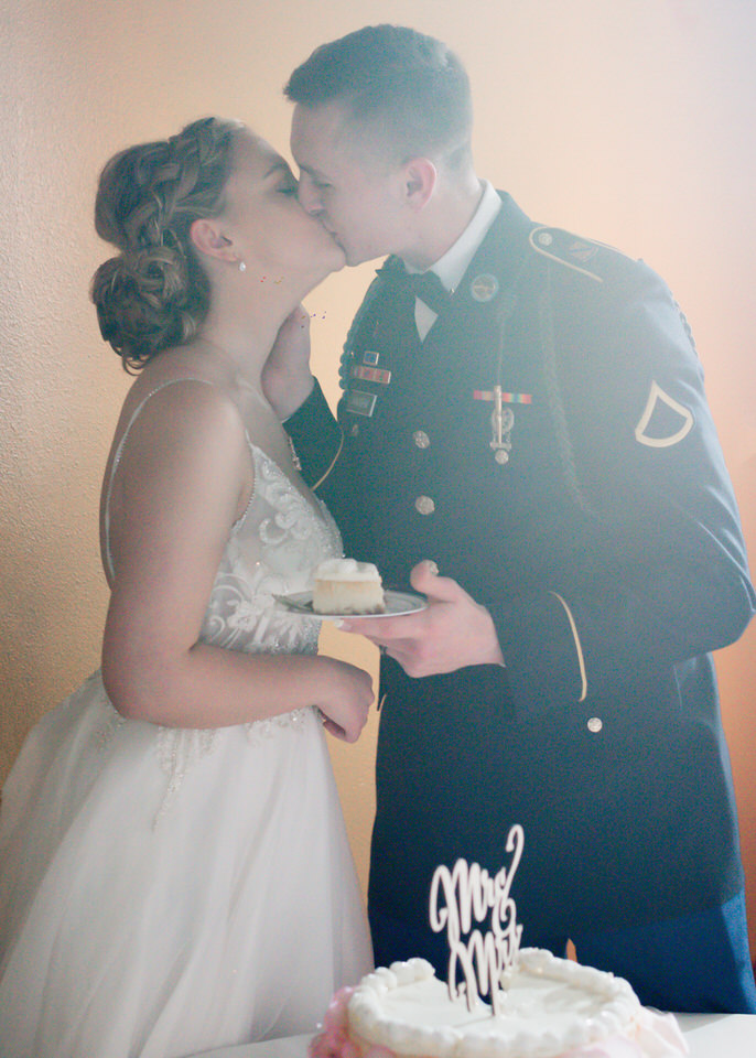 cake cutting and kiss winter wedding indoor rainy day cservinphotographs.jpg