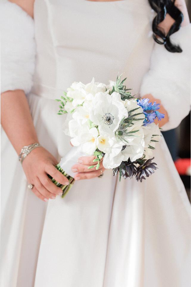 Bride holding white floral bouquet CServinPhotographs Seattle wedding-1.jpg