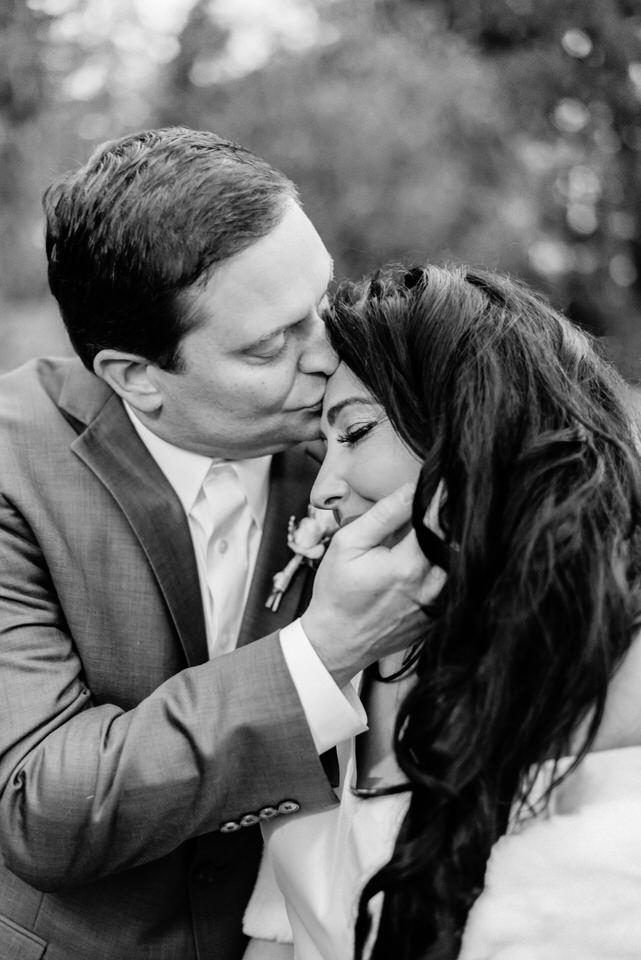 Groom kissing bride on forehead romantic Seattle wedding CServinPhotographs-1.jpg