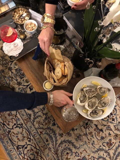 Elisabetta insisted we have a chic little  aperitivo  in the form of raw oysters, salted French butter, Campari for Diego and fine Italian bubbly for us.