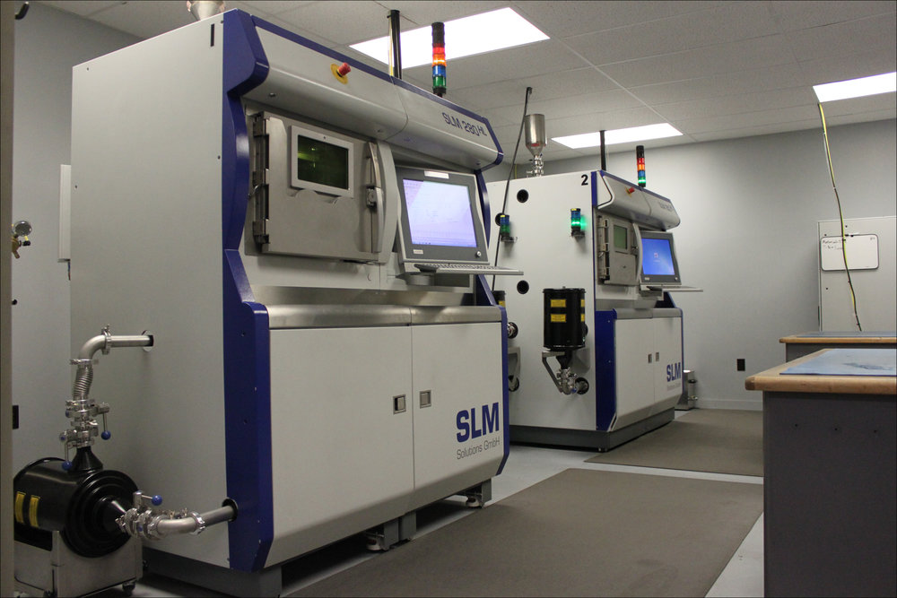 Two of our SLM 280 HL metal 3D printers in our additive manufacturing laboratory.
