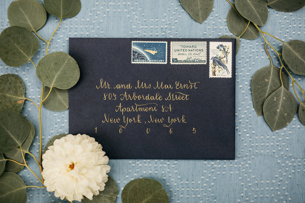 Gold Calligraphy on Navy Envelope for a Michigan Wedding. Photo by Cat Carty Buswell.