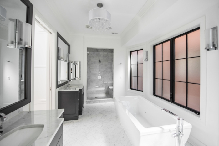Black and white never goes out of style in this bathroom we designed for an elegant single family home.