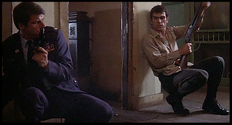 Devane and Jones finding a hollow catharsis during the film's final massacre.