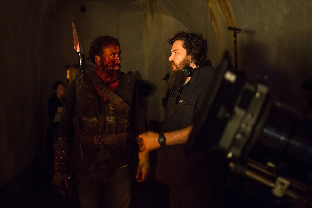"(L-R)  Nicolas Cage  and Director  Panos Cosmatos  behind the scenes of the action, thriller film  "" MANDY ""  an  RLJE Films  release. Photo courtesy of  RLJE Films ."