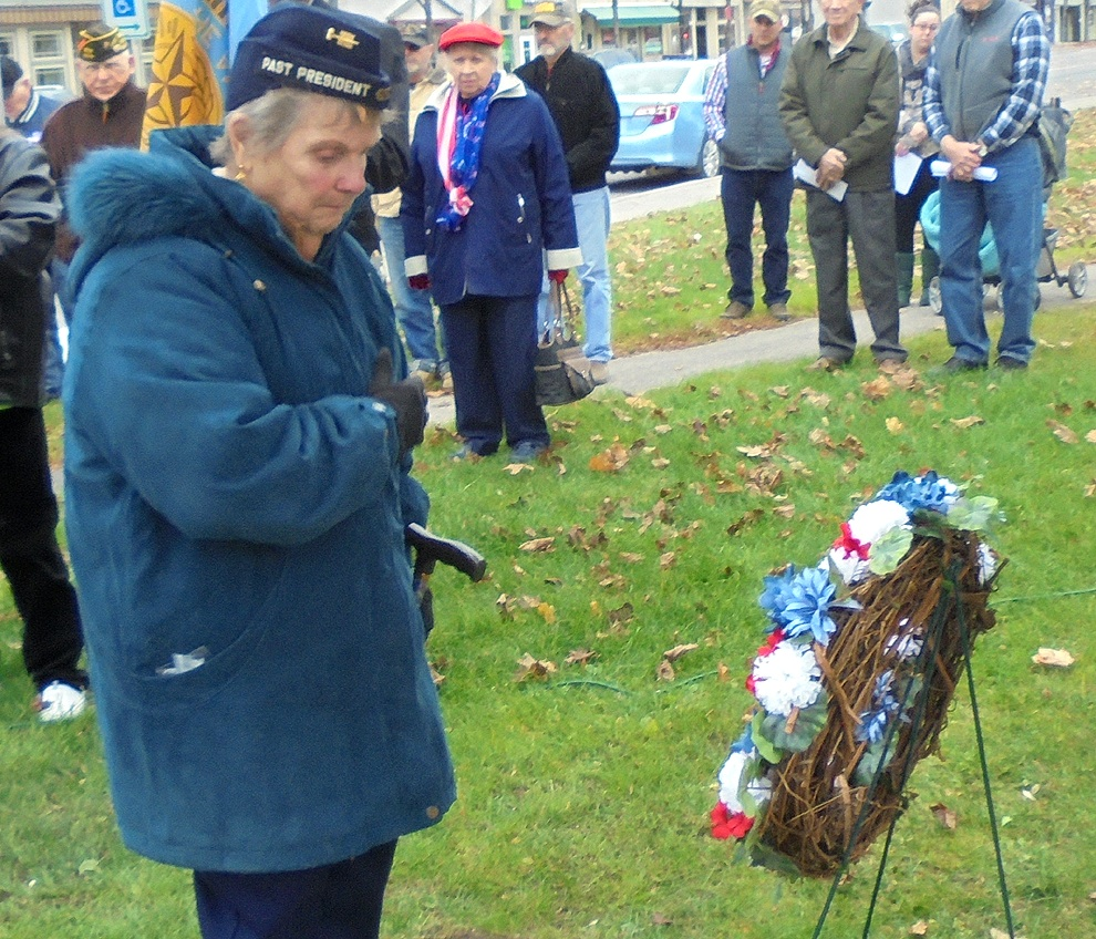 Gouverneur American Legion Ladies Auxiliary President Gloria Youngs is shown presenting flowers at the observance of Veterans Day held on Friday, November 11.