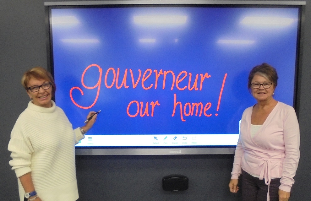 On a recent visit home to Gouverneur, Kay Van Norton Poche (left), now of Sydney, Australia and Gouverneur Community Center board member Donna Lawrence showed off the new Smart Board in the Howard Van Norton Media Room that was made possible by the generous donation made by the Van Norton family to the new center located on State Highway 58.  (Wyman photo)