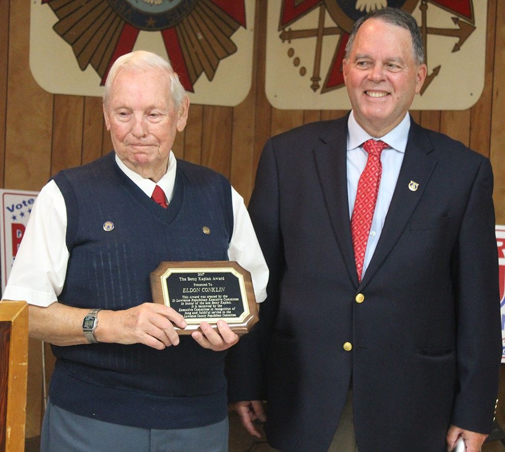 Eldon Conklin of Gouverneur (left) holding the 2017 Betsy Kaplan Award after it was presented to him by SLC Republican Committee Chairman Thomas Jenison (right). (Rachel Hunter photo)