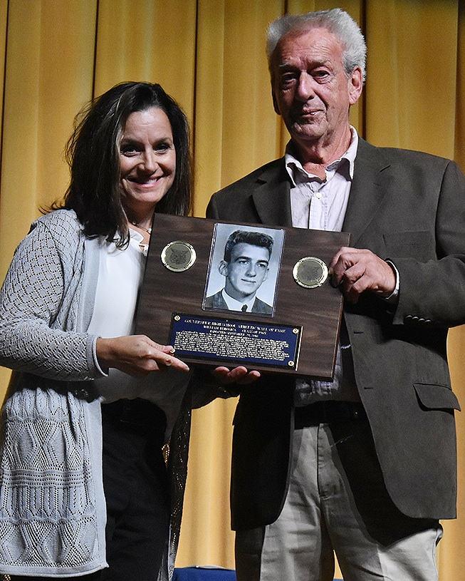 William Tehonica (right) is proudly presented with his 2018 Gouverneur High School Athletic Wall of Fame Plaque from daughter, Billie Joe Strife (left). (photo by Jessyca Cardinell)