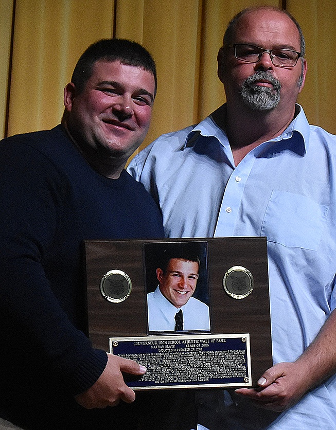 Nathan Slate, GHS Class of 2006, (left) is presented with his 2018 Gouverneur High School Athletic Wall of Fame Plaque from Coach Mark Dailey (right). (photo by Jessyca Cardinell)