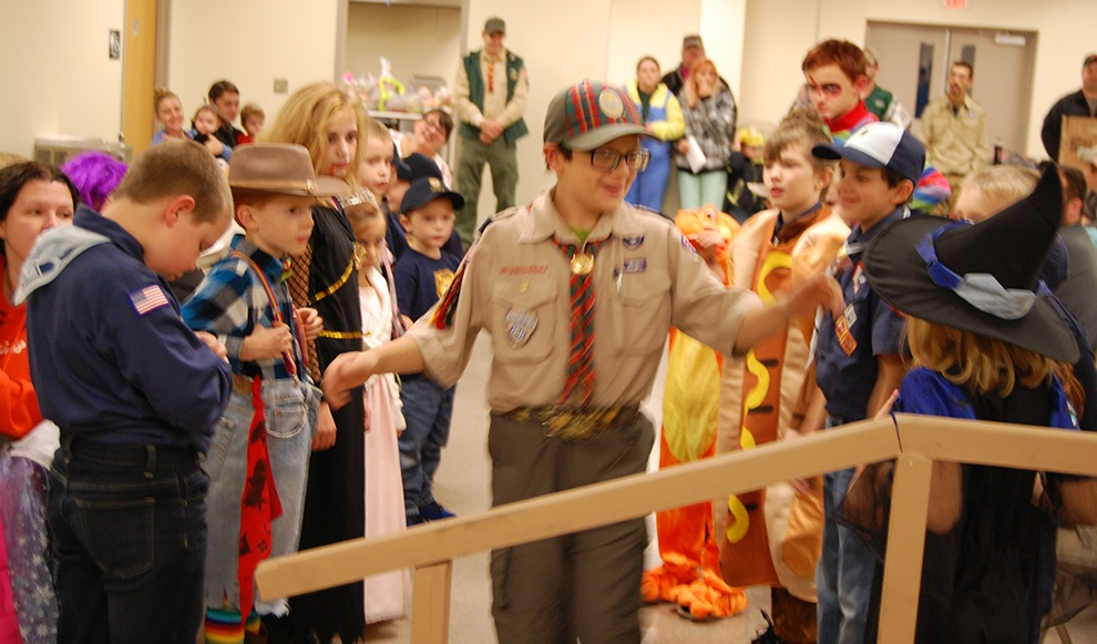 Jack Velez is congratulated and given a final farewell by fellow Cub Scouts during their Halloween Pack Meeting and Crossover Ceremony. (photo provided)