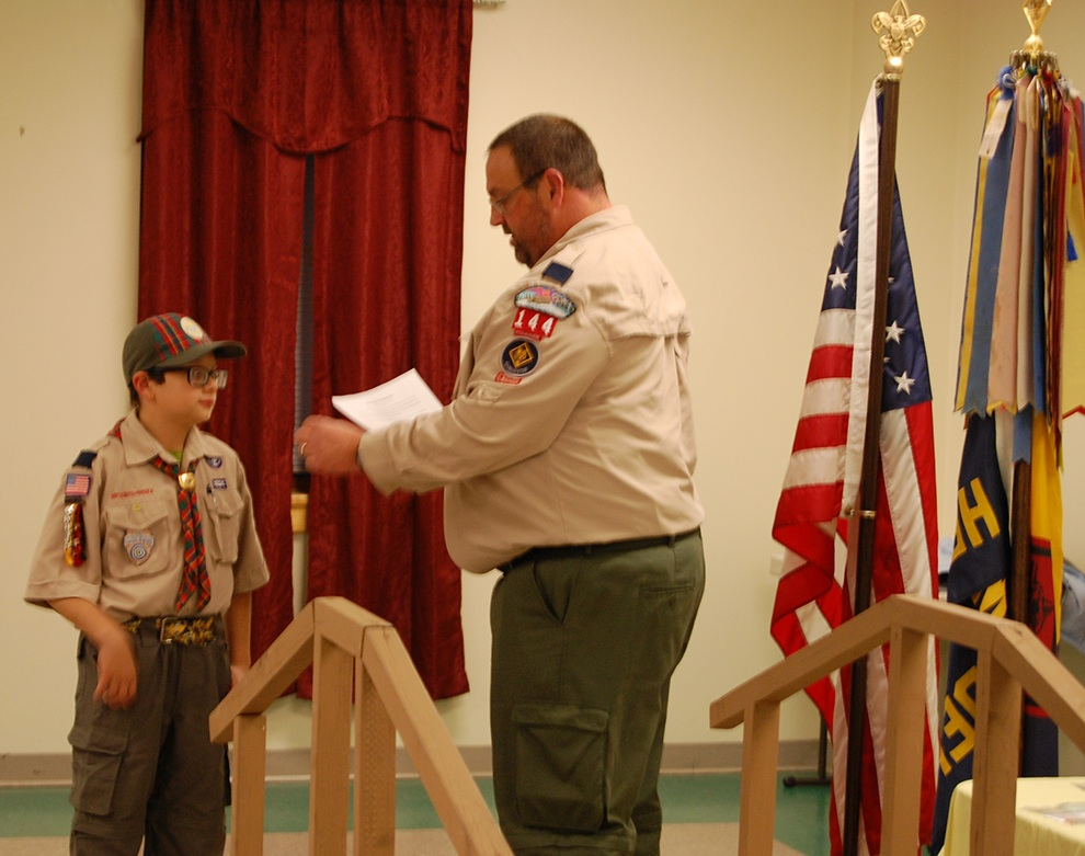 Jack Velez receives his Arrow of Light Award from Cubmaster George Kotz. (photo provided)