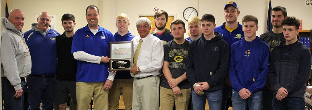 The 2018 Gouverneur Wildcat Varsity Football Team was honored for its outstanding season by the Village of Gouverneur Board of Trustees at its Feb. 19 meeting. The plaque was presented by Mayor Ron McDougall and accepted by Head Coach Sean Devlin, joined by the coaching staff and student-athletes. From left: Coach Frank Bush, Coach Travis Dann, Garrison Gonyeau, Coach Sean Devlin, Nick Jenkins, Mayor Ron McDougall, Dave Baker, Shane Shampine, Jake Shippee, Mitchell Shippee, Logan Garrison, Cayden Stowell, Keegan Matthews, Caleb Farr. (Rachel Hunter photo)