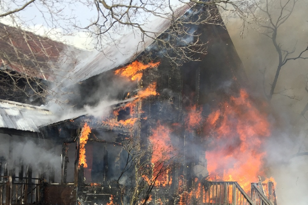 Fiery blaze consuming the Welch Road home in the Town of Gouverneur. The Gouverneur Fire Department determined it a total loss. (photo provided)