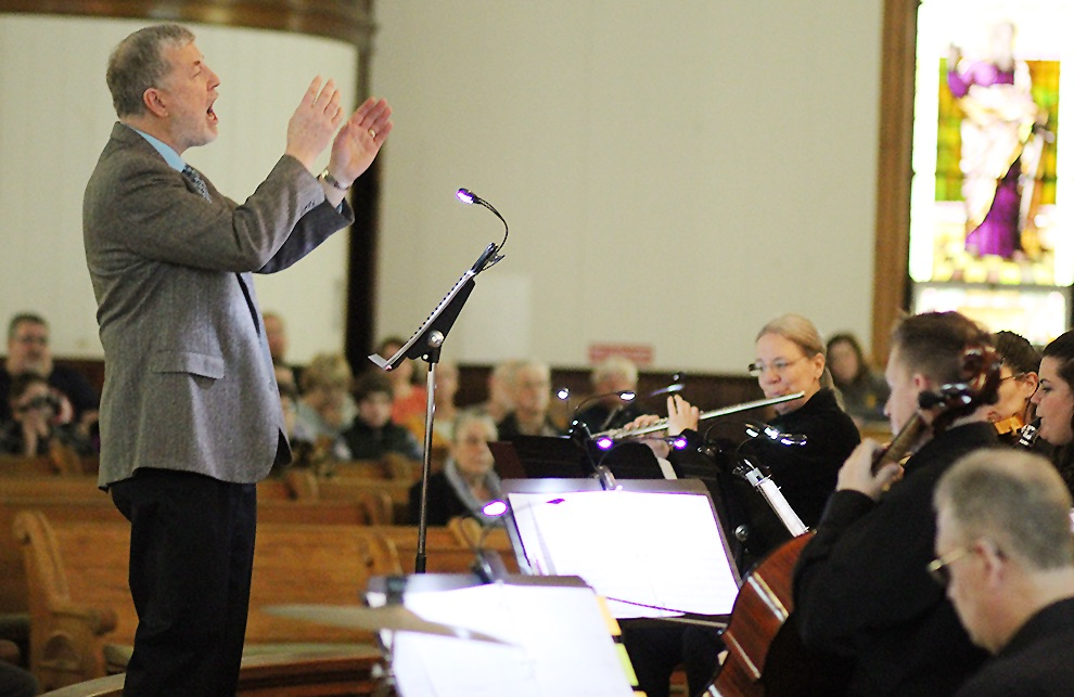"""Dr. Donald Schuessler, Jr. conducting the Gouverneur Community Chorus and instrumentalists performing """"The Song Everlasting"""" by Joseph M. Martin on Sunday, April 14 at the First United Methodist Church of Gouverneur. (Rachel Hunter photo)"""