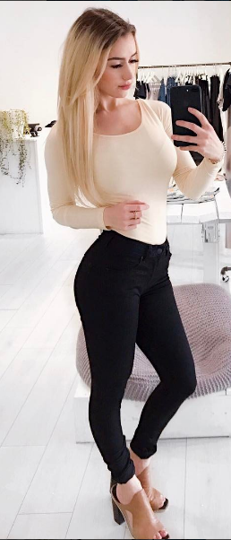 Nude Bodysuit and high-waited black jeans makes neutral on neutral chic, not boring.