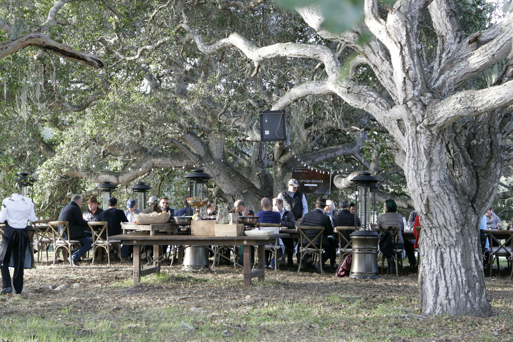 Community Table Conversations - Experience farm-to-table dining outside in conversation with a diverse group of thinkers and doers .