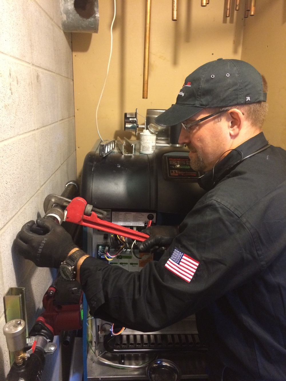 PJ's Service Technician working on a boiler